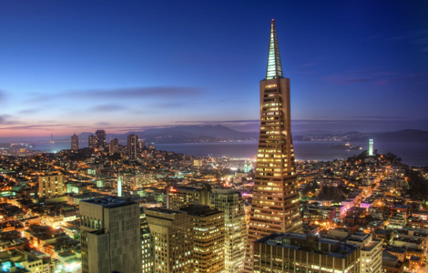 The Deluxe Evening Tour offers views of a glowing San Francisco
